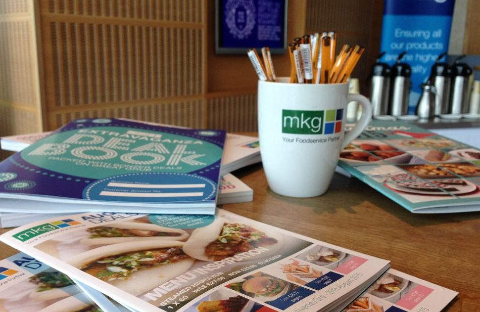 Brochures and merchandise at the MKG Extravaganza event